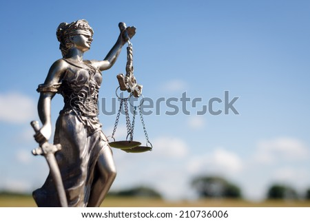 sculpture of themis, femida or lady justice goddess on bright blue sky copy space background - stock photo
