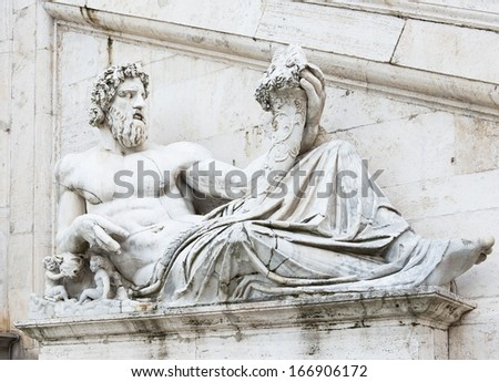 Sculpture of Tiber river in the Capitolium planed by Michelangelo in Rome. Italy - stock photo