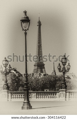 Sculpture on Alexandre III bridge. The bridge, with its exuberant Art Nouveau lamps, cherubs, nymphs and winged horses at either end, was built between 1896 and 1900. Antique vintage. - stock photo