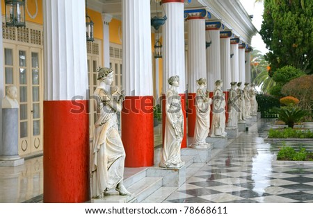 Sculptured Greek influenced figures on the grounds of the Achillion Palace on the island of Corfu. - stock photo