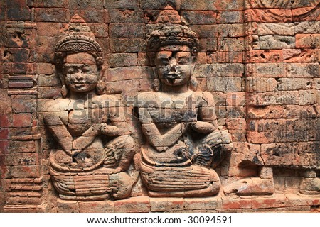Sculptures in a wall of temple,angkor - stock photo