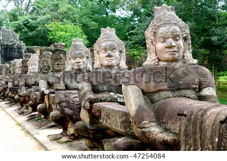 Sculptures of demons. Photographed in the temple complex of Angkor Wat, Cambodia - stock photo