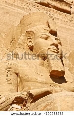 Sculptures of King Ramses II and queen Nefertari in Abu Simbel Temple - stock photo