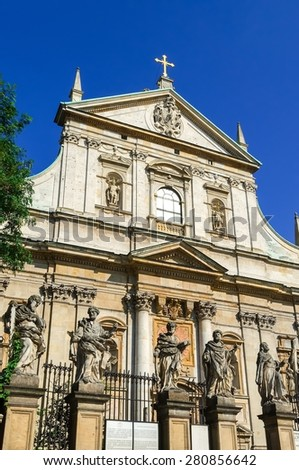 Sculptures of saints. Facade and architectural details of the Church of the Apostles St. Peter and Paul in old town in Krakow, Poland. - stock photo