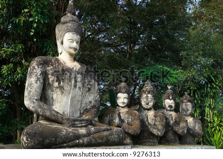 Sculptures of the Buddha and four apprentices. - stock photo