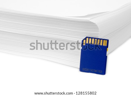 Sd memory card with a stack of printer paper. Hard copy backup or go paperless idea. - stock photo