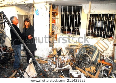 SDEROT, ISR - MAR 03 2008:Palestinian rocket hits Israeli house.Since 2001 over 15,000 rockets hit Israel killed 28 injured 1900 people widespread psychological trauma and disruption of daily life. - stock photo