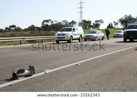 SDEROT - Jan 10: the remnants of an exploded Qassam rocket on the road with a police cars at the background