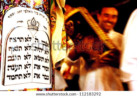 SDEROT - OCTOBER 14:Orthodox Jewish Men celebrate Simchat Torah on Oct 14 2006 in Sderot, Israel. Simchat Torah is a celebratory Jewish holiday marks the completion of the annual Torah reading cycle. - stock photo