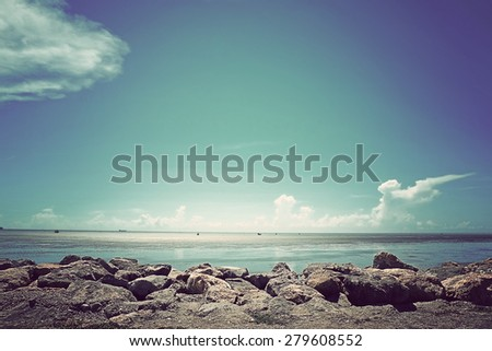 Sea and Beach on white cloud sky background with vintage tone - stock photo