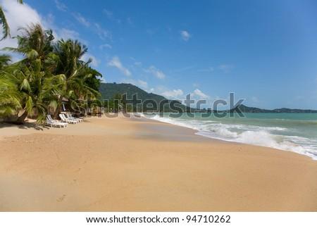 sea and beach with coconut palm on Lamai Beach in Koh Samui, Thailand - stock photo