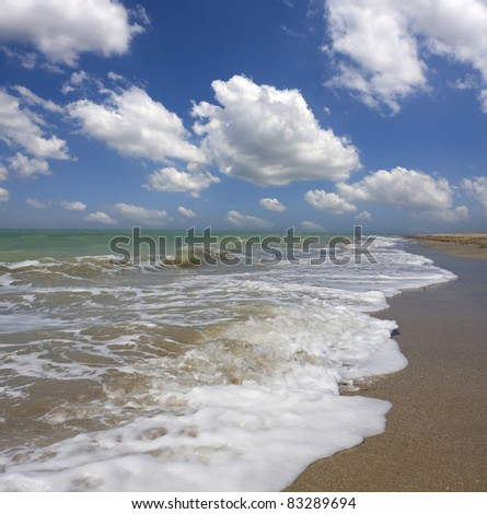 sea and nice clouds in sky - stock photo