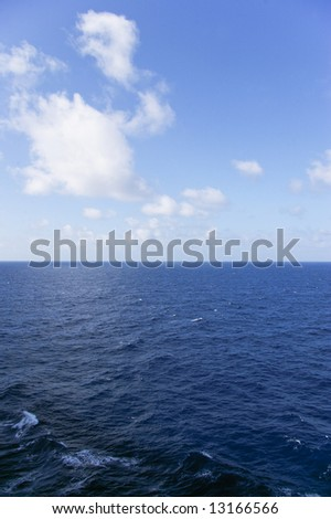 sea and sky in caribbean vertical position - stock photo