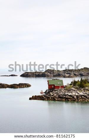 Sea archipelago with a house on a island - stock photo