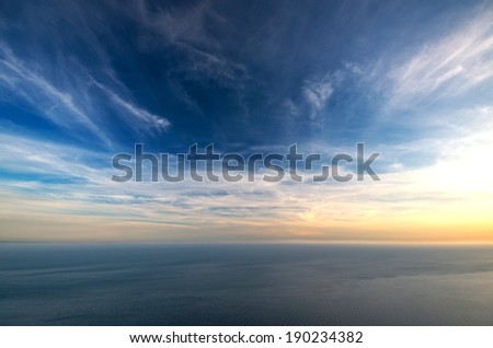 Sea at sunset with the heights of the mountains - stock photo