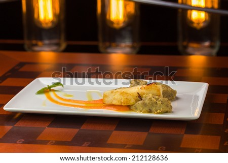 Sea bass fish fillet on bar background - stock photo