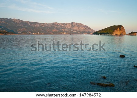 Sea bay with view of the island of St. Nicholas in Montenegro - stock photo