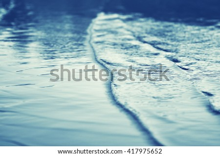 sea beach after sunset in summer, soft focus effect - stock photo