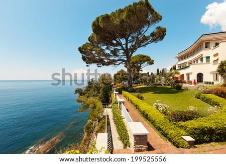 sea, beautiful landscape from the garden of a villa - stock photo
