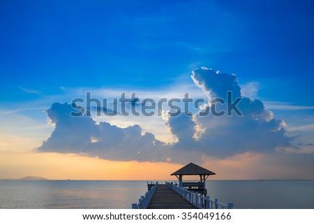 sea bridge at sunset sky - stock photo