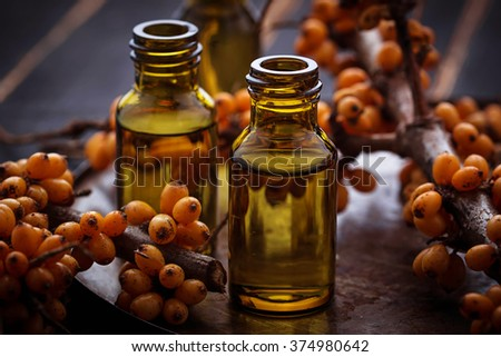 Sea buckthorn oil in small bottles. Selective focus - stock photo