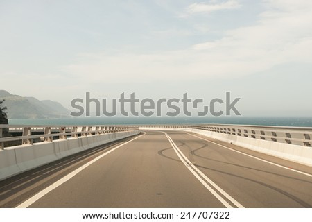 Sea Cliff Bridge burnout tyre marks - stock photo