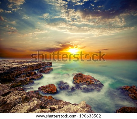 Sea cliffs and sunset over the sea. Vintage style - stock photo