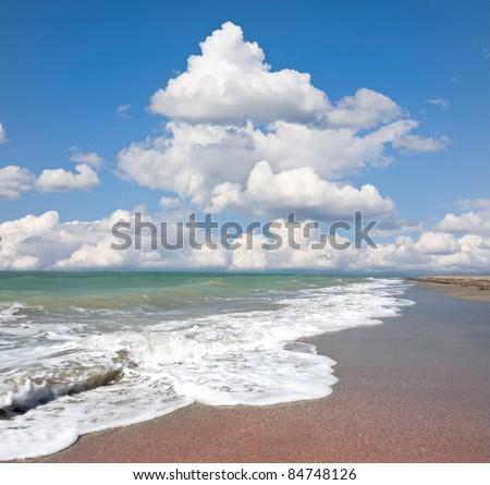 Sea coast under nice sky - stock photo