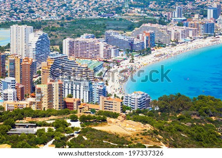 Sea coast with people and the city under the sun (Costa Brava - Spain) - stock photo
