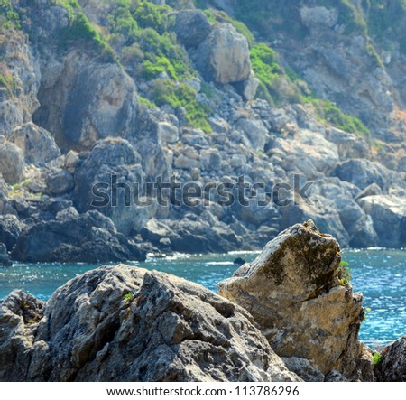 Sea coast with rock formations - stock photo