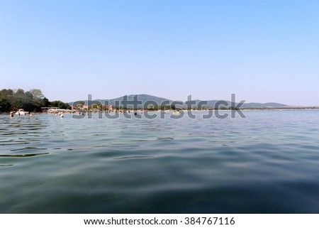 Sea expanse and remote beach - stock photo