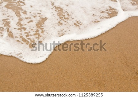 Sea Foam on the Sand Background Image