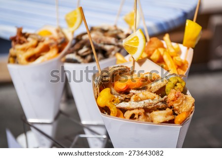 Sea food in cones on the street of Italy - stock photo