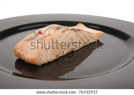 sea food : roasted pink salmon fillet with chinese onion, on black dish isolated over white background - stock photo