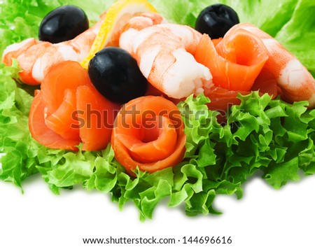 Sea foods - Shrimp and Salmon. Garnished with Fresh Raw Salad Leaf.