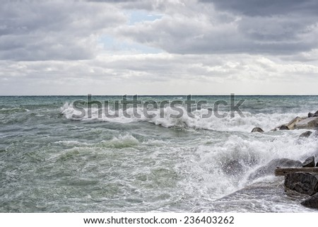 sea in tempest on rocks with splashes