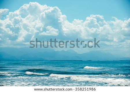 sea, landscape, ocean, water, waves, clouds and mountains, the smell and feeling, all in one shot - stock photo