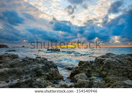 Sea landscape with bad weather, rocks and blue cloudy sky