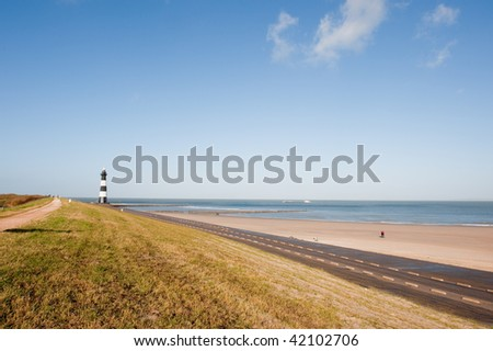 Sea landscape with lighthouse at the beach - stock photo