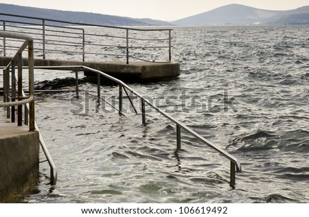 Sea level rise - climate change concept - stock photo