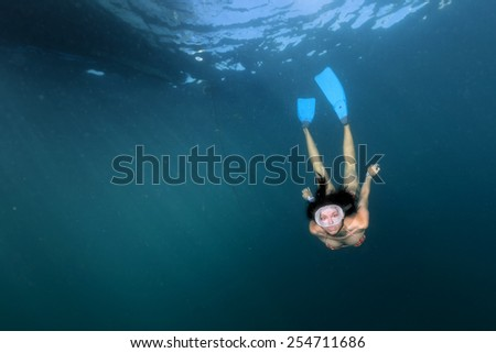 sea lion seal coming to black hair diver girl underwater - stock photo