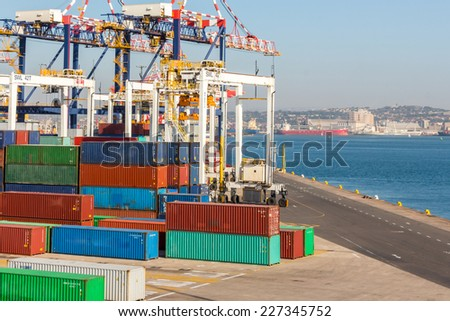 Sea merchant port, container terminal with colored containers. - stock photo