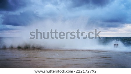 Sea on a stormy day. lighthouse.long exposure was used to capture the image.