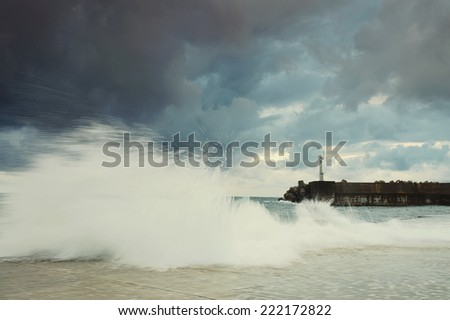 Sea on a stormy day. .lighthouse.long exposure was used to capture the image. - stock photo