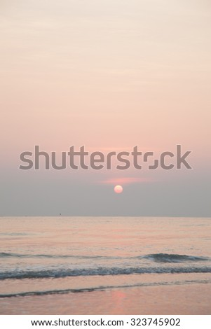 sea on the evening. The sun is about to fall in the evening. - stock photo