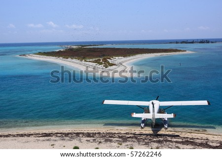 Sea plane docking at Dry Tortugas National Park - stock photo