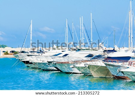 sea port with boats in the beautiful sunny day in Vieste Italy - stock photo