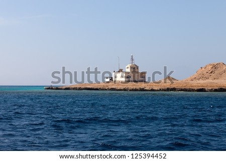 Sea Radar on stony bare mountain under a clear blue sky - stock photo