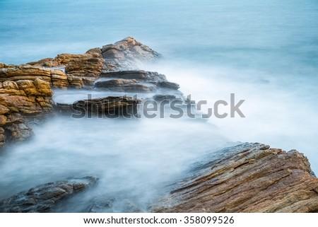 sea rocks in early morning, slow speed shot, make sea water atomization.koh samet island,thailand - stock photo