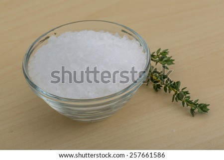 Sea salt heap crystal with thyme branch - stock photo